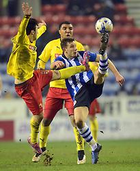 Watford's Fernando Forestieri challenges Wigan's Jason Pearce  - Photo mandatory by-line: Richard Martin-Roberts/JMP - Mobile: 07966 386802 - 17/03/2015 - SPORT - Football - Wigan - DW Stadium - Wigan Athletic  v Watford - Sky Bet Championship