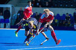 Holcombe's Adam Jordan is tackled by Andrew Eversden of Team Bath Buccaneers. Holcombe v Team Bath Buccaneers - Now: Pensions Finals Weekend, Lee Valley Hockey & Tennis Centre, London, UK on 12 April 2015. Photo: Simon Parker