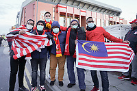 Football - 2019 / 2020 UEFA Champions League - Round of Sixteen, Second Leg: Liverpool (0) vs. Atletico Madrid (1)<br /> <br /> Fan arrive for tonights game wearing masks, at Anfield.<br /> <br /> <br /> COLORSPORT/TERRY DONNELLY