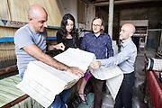 Soveria Mannelli (CZ) - Lanificio Sala di tessitura Jacquard. Emilio S. Leo controlla insieme allo Studiocharlie (Rovato - BS) i primi<br /> cartoni del disegno Punto Pecora (2004), un raffinato e complesso ragionamento sul logo del Lanificio Leo.