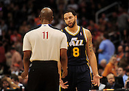 Feb. 15, 2011; Phoenix, AZ, USA; Utah Jazz guard Deron Williams (8) talks with NBA Official Derrick Collins (11) during a game against the Phoenix Suns at the US Airways Center.  The Suns defeated the Jazz 102-101. Mandatory Credit: Jennifer Stewart-US PRESSWIRE