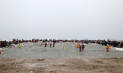 Spectators wait for the start of the 14th Annual Polar Bear Plunge at Ontario Beach Park on Sunday, February 9, 2014.