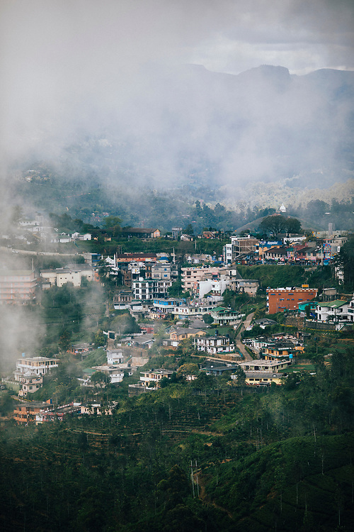 Hapatule, Sri Lanka -- February 3, 2018: Mist rolls over the mountains into the town of Hapatule.