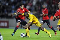 Fotball<br /> Frankrike<br /> Foto: Dppi/Digitalsport<br /> NORWAY ONLY<br /> <br /> FOOTBALL - UEFA EUROPA LEAGUE 2010/2011 - PLAY OFF - 2ND LEG - LILLE OSC v FC VASLUI - 26/08/2010<br /> <br /> WESLEY (FCV) / ADIL RAMI (LOSC)