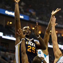 April 11, 2011; New Orleans, LA, USA; Utah Jazz center Al Jefferson (25) shoots over New Orleans Hornets point guard Chris Paul (3) and shooting guard Marco Belinelli (8) during the first half at the New Orleans Arena.  Mandatory Credit: Derick E. Hingle