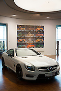 Mercedes-AMG SL63 AMG V8 biturbo coupe car in Diamond White colour at Mercedes-AMG showroom in Stuttgart, Bavaria, Germany