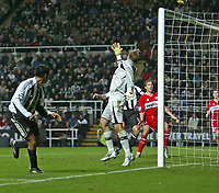 Photo: Andrew Unwin.<br />Newcastle United v Middlesbrough. The Barclays Premiership. 02/01/2006.<br />Newcastle's Nolberto Solano (L) beats Middlesbrough's goalkeeper, Mark Schwarzer (C), but puts his header over the bar.