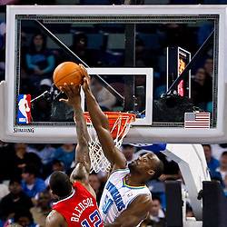 November 9, 2010; New Orleans, LA, USA; Los Angeles Clippers point guard Eric Bledsoe (12) has his shot blocked by New Orleans Hornets center Emeka Okafor (50) during the second half at the New Orleans Arena. The Hornets defeated the Clippers 101-82. Mandatory Credit: Derick E. Hingle