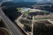 """Nederland, Limburg, Venlo, 07-03-2010; aanleg park voor de Wereldtuinbouwtentoonstelling Floriade 2012 door ARCADIS en Dura Vermeer Infrastructuur. Het park ligt in de 'oksel' van knooppunt Zaarderheiken, vlak bij het tuinbouwgebied en de veiling en is is onderdeel van bestemmingsplan Klavertje 4 (met onder andere Tradeport, Freshpark Venlo/ Greenpark Venlo).Construction of the park for the World Horticultural Exhibition Floriade 2012 by ARCADIS Infrastructure and Dura Vermeer. The park lies in the """"armpit"""" of Zaarderheiken near the horticultural area and the auction. .luchtfoto (toeslag), aerial photo (additional fee required).foto/photo Siebe Swart"""