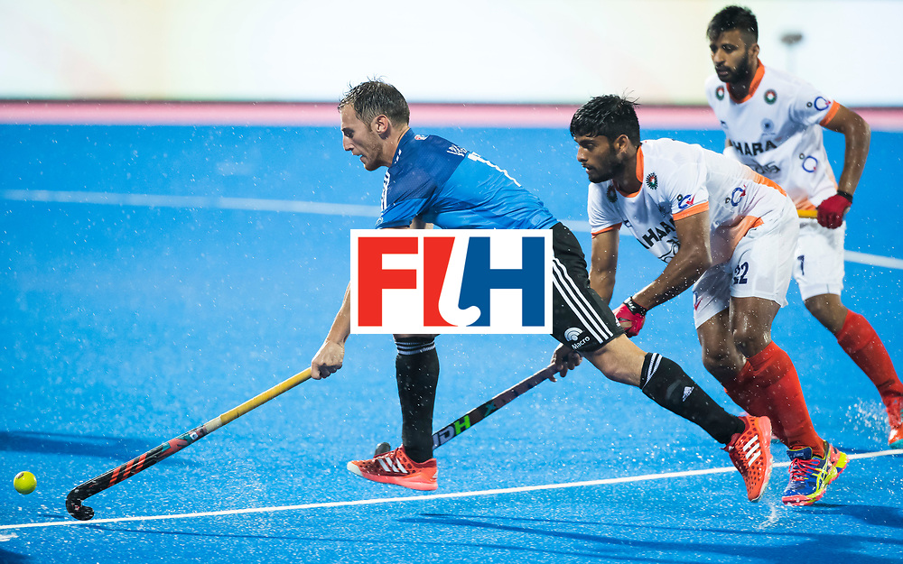 BHUBANESWAR -  Hockey World League finals , Semi Final . Argentina v India. Lucas Vila (Arg) met Varun Kumar (Ind) .COPYRIGHT KOEN SUYK
