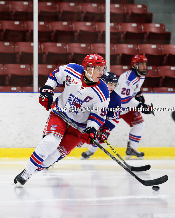 NORTH YORK, ON - Oct 25, 2015 : Ontario Junior Hockey League game action between Oakville and North York.<br /> Ryan Garvey #93 of the Oakville Blades, skates with the puck, during the second period. <br /> (Photo by Anna Matthews / OJHL Images)