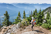 Hike the Beckler Peak Trail, 7.4 miles round trip with 2200 feet gain, in Mount Baker-Snoqualmie National Forest, Washington, USA. See vistas of  the town of Skykomish, Skykomish Valley, and Alpine Lakes, Wild Sky, and Henry M. Jackson Wilderness. Directions: Drive US Highway 2 to near Milepost 52, and turn north onto Forest Service Road 6066. Drive 6.6 miles on a gravel road to the Jennifer Dunn Trailhead.