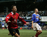 Photo: Lee Earle.<br /> Portsmouth v Manchester United. The Barclays Premiership. 11/02/2006. United's Cristiano Ronaldo (L) celebrates after scoring their third goal.