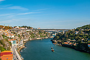 Porto cityscape and Douro river as seen from the top of Dom Luis I Bridge, Porto, Portugal looking east