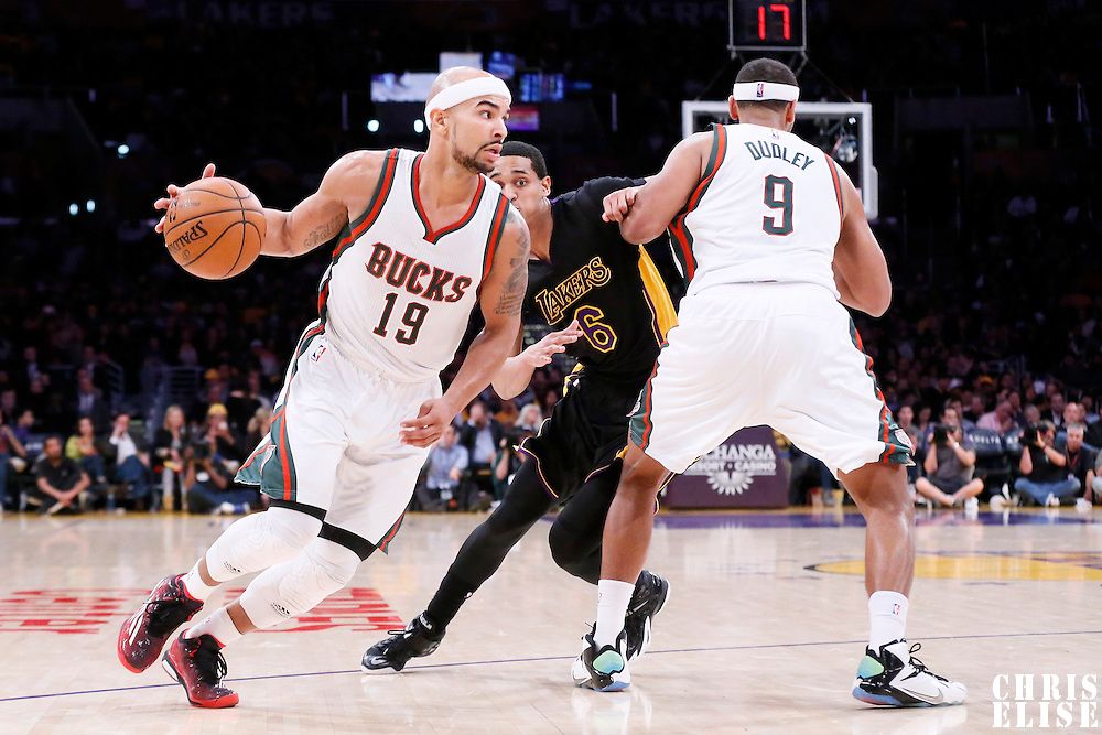 27 February 2015: Milwaukee Bucks guard Jerryd Bayless (19) drives past Los Angeles Lakers guard Jordan Clarkson (6) on a screen set by Milwaukee Bucks guard Jared Dudley (9) during the Los Angeles Lakers 101-93 victory over the Milwaukee Bucks, at the Staples Center, Los Angeles, California, USA.