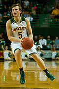 WACO, TX - JANUARY 28: Brady Heslip #5 of the Baylor Bears drives to the basket against the West Virginia Mountaineers on January 28, 2014 at the Ferrell Center in Waco, Texas.  (Photo by Cooper Neill/Getty Images) *** Local Caption *** Brady Heslip