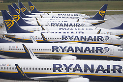 © Licensed to London News Pictures.<br /> 26/07/2020.  Stansted, UK. Ryanair passenger aircraft at Stansted Airport as travellers return to UK from Spain and will have to quarantine for two weeks after the government decision last night. Spain has seen a spike in coronavirus cases with more than 900 new cases of the virus reported on Friday. Photo credit: Marcin Nowak/LNP