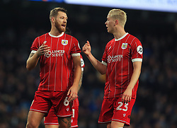Nathan Baker of Bristol City talks with Hordur Magnusson  - Mandatory by-line: Matt McNulty/JMP - 09/01/2018 - FOOTBALL - Etihad Stadium - Manchester, England - Manchester City v Bristol City - Carabao Cup Semi-Final First Leg