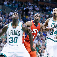 08 March 2013: Atlanta Hawks power forward Anthony Tolliver (4) vies for the rebound with Boston Celtics power forward Brandon Bass (30) and Boston Celtics small forward Paul Pierce (34) during the Boston Celtics 107-102 OT victory over the Atlanta Hawks at the TD Garden, Boston, Massachusetts, USA.