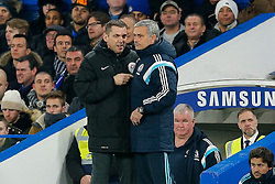 Chelsea Manager Jose Mourinho (R) has a discussion with the fourth official - Photo mandatory by-line: Rogan Thomson/JMP - 07966 386802 - 27/01/2015 - SPORT - FOOTBALL - London, England - Stamford Bridge - Chelsea v Liverpool - Capital One Cup Semi-Final Second Leg.