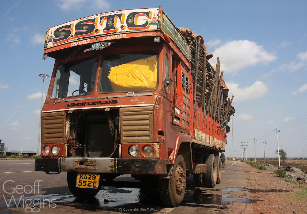 Damaged Ashok Leyland truck with broken window and radiator on the roadside in Karnataka, India