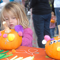 Bodhi Milano, 3, doctorates her pumpkin during the Santa Monica Main Street Farmers Market on Sunday, October 24, 2010.