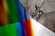 """Pedestrians walk past a mural on the corner of Brazos and Second streets on Friday, April 5, 2019, in Austin, Texas.  The artwork, titled """"Tau Ceti,"""" is the city's tallest piece of art and was completed in November by artist Josef Kristofoletti. [NICK WAGNER/AMERICAN-STATESMAN]"""