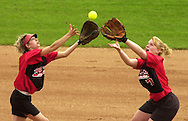 McPherson's Lindsey Moors and Devin Bersuch (7) both reach for a fly ball behind second base in the first game of a doubleheader against Hutchinson Friday at Fun Valley. Moors caught the ball on the play. Travis Morisse 4-20-01