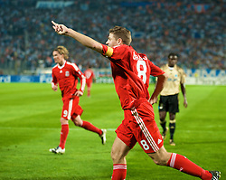 MARSEILLE, FRANCE - Tuesday, September 16, 2008: Liverpool's captain Steven Gerrard MBE celebrates scoring the second goal against Olympique de Marseille from the penalty spot during the opening UEFA Champions League Group D match at the Stade Velodrome. (Photo by David Rawcliffe/Propaganda)