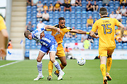 Colchester Utd forward Chris Porter jockeys with Cambridge Utd defender Leon Legge during the EFL Sky Bet League 2 match between Colchester United and Cambridge United at the Weston Homes Community Stadium, Colchester, England on 13 August 2016. Photo by Nigel Cole.