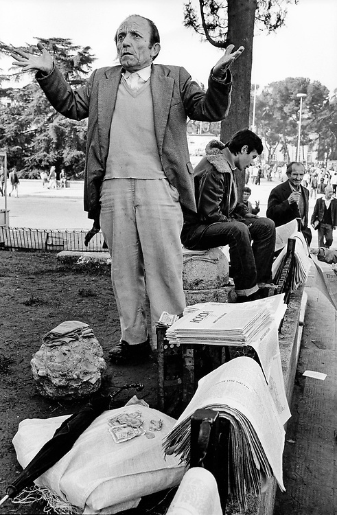ALBANIA - Albanien - 1991 - Transition from communism to democracy; Street scene in Tirana - Bad news - Newspaper Seller 10/1991; © Christian Jungeblodt