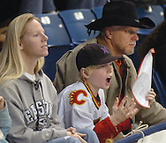 1/19/07 -- Omaha, NE THe Schulz family L-R Jennifer, Wyatt (10) and Jim react to a call during  Aksarben Knights game Friday night..Photo by Chris Machian/Prairie Pixel Group
