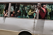 """A passerby screams """"take them all back"""" at the crowds of Dominican citizens of Haitian descent that crowded the streets around the Ministry of the Interior in Santo Domingo to register for the regularization plan."""