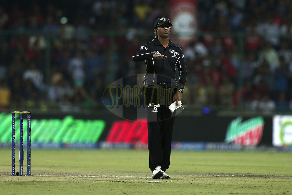 Signals a four by umpire Kumar Dharmasena during match 45 of the Pepsi Indian Premier League Season 2014 between the Delhi Daredevils and the Kings XI Punjab held at the Feroz Shah Kotla cricket stadium, Delhi, India on the 19th May  2014<br /> <br /> Photo by Deepak Malik / IPL / SPORTZPICS<br /> <br /> <br /> <br /> Image use subject to terms and conditions which can be found here:  http://sportzpics.photoshelter.com/gallery/Pepsi-IPL-Image-terms-and-conditions/G00004VW1IVJ.gB0/C0000TScjhBM6ikg