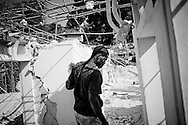 A man walks through his home which was destroyed during the recent earthquake in Port-au-Prince, Haiti.
