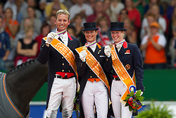Podium Grand Prix Special<br /> 1. Adelinde Cornelissen (NED)<br /> 2. Carl Hester (GBR)<br /> 3. Bechtolsheimer Laura (GBR)<br /> European Championships Dressage - Rotterdam 2011<br /> © Dirk Caremans