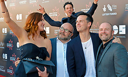 Edinburgh International Film Festival, Saturday, 24 June 2018<br /> <br /> STEEL COUNTRY (WORLD PREMIERE)<br /> <br /> Pictured:  Director of Photography Marcel Zyskind photobombs as Bronagh Waugh takes a selfie with  producer Gareth Unwin, Andrew Scott and director Simon Fellows<br /> <br /> (c) Alex Todd | Edinburgh Elite media