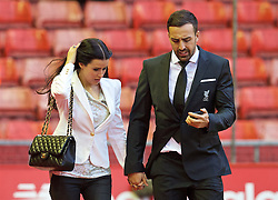LIVERPOOL, ENGLAND - Sunday, November 8, 2015: Liverpool's Jose Enrique and his partner Amy Jaine arrive at Anfield ahead of the Premier League match against Crystal Palace. (Pic by David Rawcliffe/Propaganda)