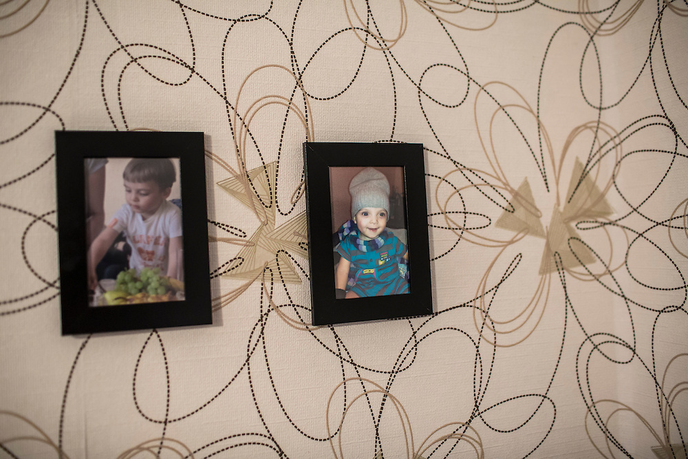 YEKATERINBURG, RUSSIA - OCTOBER 16: Photographs of Svetlana's 2-year-old son hang over her bed at City Without Drugs on October 16, 2013 in Yekaterinburg, Russia. Svetlana, who comes from Perm, is 22 and addicted to heroin. City Without Drugs is a well-known narcotics treatment program in Russia founded by Yevgeny Roizman, who was elected mayor of Yekaterinburg in September 2013. (Photo by Brendan Hoffman/Getty Images) *** Local Caption ***