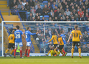 Newport County defender Darren Jones beats Portsmouth goalkeeper Ryan Fulton to head home the opening goal 0-1 during the Sky Bet League 2 match between Portsmouth and Newport County at Fratton Park, Portsmouth, England on 12 March 2016. Photo by Adam Rivers.