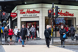 View of pedestrian street crossing outside branch of Tim Hortons coffee shop on Argyll Street Glasgow, Scotland, United Kingdom