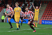 Billy Waters celebrates his 1st goal during the Vanarama National League match between Cheltenham Town and Chester City at Whaddon Road, Cheltenham, England on 5 December 2015. Photo by Antony Thompson.