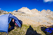 Backpacker looking out from tent in Dusy Basin, Kings Canyon National Park, California USA