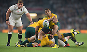 Twickenham, Great Britain,     Will GENIA clears the ball, during the Pool A game, England vs Australia.  2015 Rugby World Cup, Venue, RFU Stadium, Twickenham, Surrey, ENGLAND.  Saturday  03/10/2015<br /> Mandatory Credit; Peter Spurrier/Intersport-images]