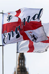 © Licensed to London News Pictures. 19/12/2018. London, UK. The English St George's flag flies in Westminster as today marks 100 day countdown to UK Brexit. The British people voted in a referendum to leave the EU and will formally leave by March 29 2019. Photo credit: Ray Tang/LNP