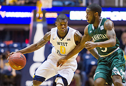 Nov 28, 2016; Morgantown, WV, USA; West Virginia Mountaineers guard Teyvon Myers (0) drives past Manhattan Jaspers guard Tyler Wilson (5) during the first half at WVU Coliseum. Mandatory Credit: Ben Queen-USA TODAY Sports
