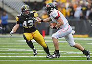 October 03, 2009: Arkansas State quarterback Corey Leonard (1) tries to get around Iowa linebacker Pat Angerer (43) during the second half of the Iowa Hawkeyes' 24-21 win over the Arkansas State Red Wolves at Kinnick Stadium in Iowa City, Iowa on October 03, 2009.