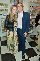 BEA FRESSON and the HON.HUMPHREY FITZROY NEWDEGATE at a party to launch Biscuiteers Fashion Biscuit Collection inspired by Alice Naylor-Leyland's wardrobe held at Biscuiteers, 194 Kensington Park Road, London W11 on 23rd June 2015.