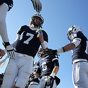 Yale quarterback Henry Furman and the Yale team take the field before the Yale V Harvard, Ivy League Football match at Yale Bowl.  The game was the 130th meeting between Harvard and Yale in the historic rivalry that dates back to 1875. New Haven, Connecticut, USA. 23rd November 2013. Photo Tim Clayton