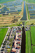 Nederland, Noord-Holland, Amsterdam, landelijk Noord, 20-04-2015; Waterland, Volgermeerpolder, voormalig veengebied, de 'petgaten' zijn volgestort met huisvuil en chemisch afval, onder andere met dioxine en benzeen afkomstig van Philips-Duphar. Inmiddels is de polder gesaneerd, de voormalige vuilstortplaats is afgedekt met folie en voorzien van en afdeklagen. Het ontwerp voorziet in een natuurgebied met 'sawa's' waarin nieuw veen zich kan ontwikkelen wat de vervuilde grond verder zal isoleren (natural capping). <br /> The Volgermeerpolder in the rural area near Amsterdam once a landfill site for heavily polluted household and industrial waste, has been cleaned up using natural capping and turned into a nature area. <br /> luchtfoto (toeslag op standard tarieven);<br /> aerial photo (additional fee required);<br /> copyright foto/photo Siebe Swart